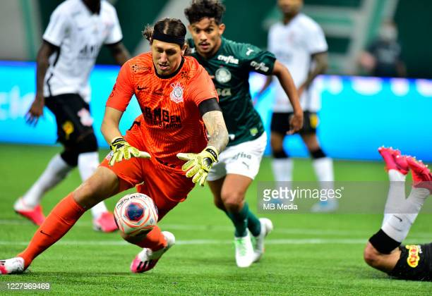 Cassio of Corinthians competes for the ball with Gustavo Scarpa of Palmeiras ,during a match between Palmeiras and Corinthians as part of the second...