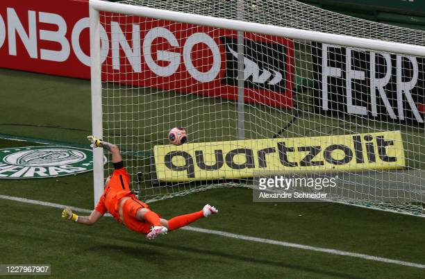 Cassio of Corinthians fails to make the save as Luiz Adriano of Palmeiras scores the first goal of his team during the match between Corinthians and...
