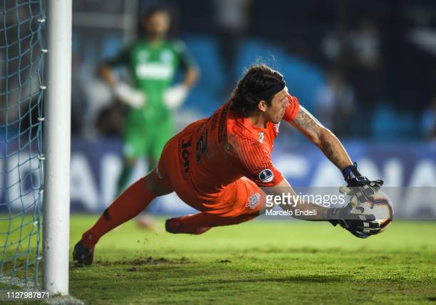 Cassio of Corinthians saves the last ball during a penalty shootout during a match between Racing Club and Corinthians as part of Copa CONMEBOL...