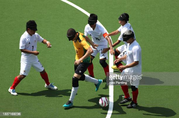 Cassio Reis of Team Brazil is surrounded by players of Team Japan during the 5-a-side football match between Team Brazil and Team Japan at the Aomi...