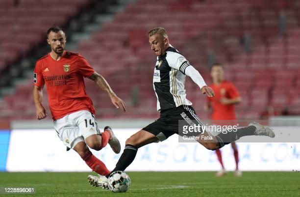 Cassio Scheid of SC Farense with Haris Seferovic of SL Benfica in action during the Liga NOS match between SL Benfica and SC Farense at Estadio da...