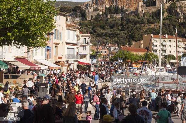 Cassis harbor quays street scene with people