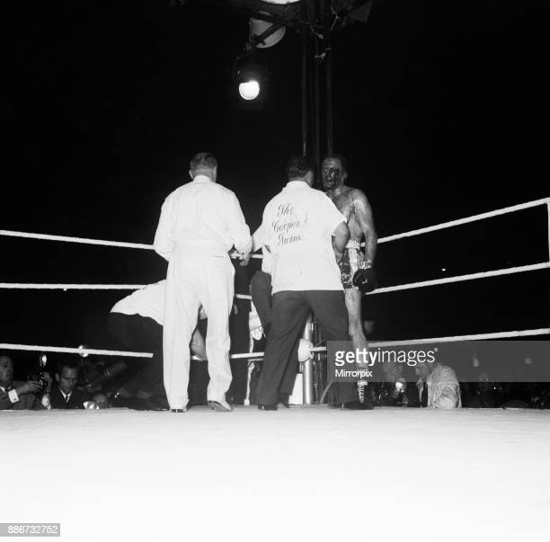 Cassius Clay aka vs Henry Cooper in their first fight at Wembley Stadium Clay stopped Cooper in the 5th round Picture shows Referee stopping the...
