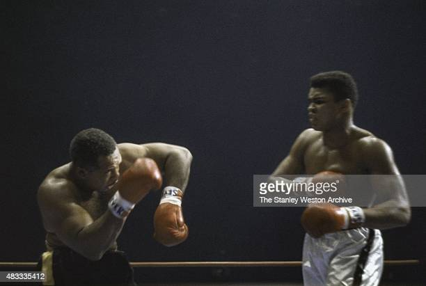 Cassius Clay and Archie Moore trade blows during their bout on November 15 1962 at Los Angeles Sports Arena in Los Angeles California NO COMMERCIAL...