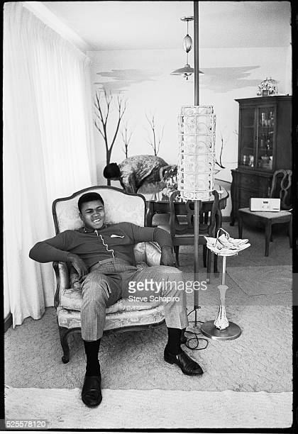 Cassius Clay at home with his Mom Odessa in the background Clay had already won an Olympic gold medal for boxing and amassed a professional record of...