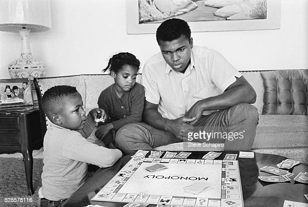 Cassius Clay at home with local children playing Monopoly Clay had already won an Olympic gold medal for boxing and amassed a professional record of...
