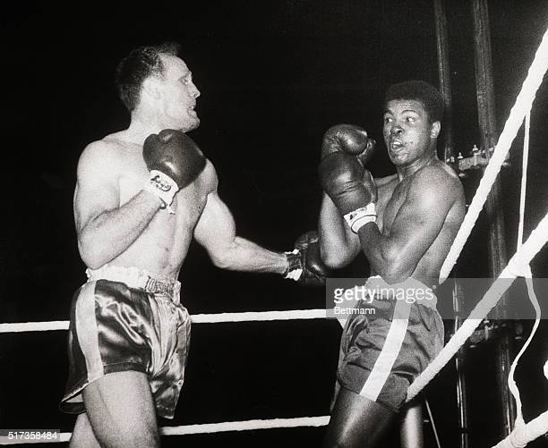 Cassius Clay before he changed his name to Muhammad Ali is bewildered by Henry Cooper's unexpected and ferocious opening attack Clay is pinned on the...