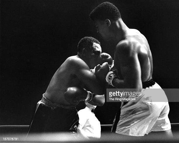 Cassius Clay connects with a right jab to Archie Moore during the fight at the Forum on November 15 1962 in Los AngelesCalifornia Cassius Clay won by...