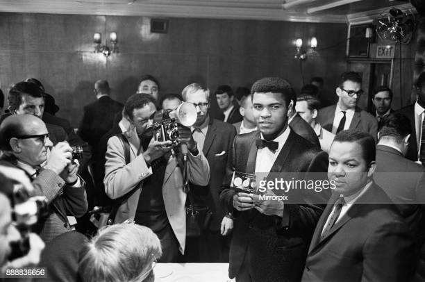 Cassius Clay holds a case with 24 carrot gold coins in memory of Winston Churchill 19th May 1966