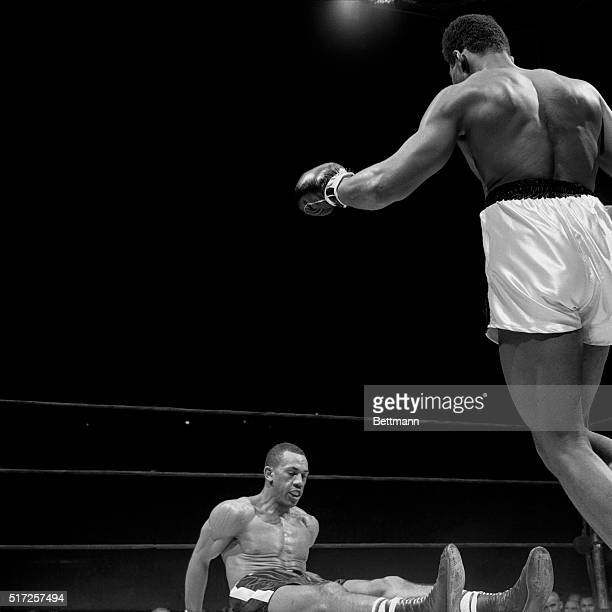 Cassius Clay hovers over Sonny Banks after flooring him in the 4th round Clay from Louisville Kentucky scored his 11th consecutive professional...