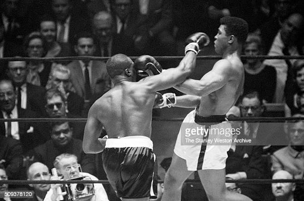 Cassius Clay in action throwing a left and avoiding a right from Doug Jones during their heavyweight bout at Madison Square Garden New York New York...