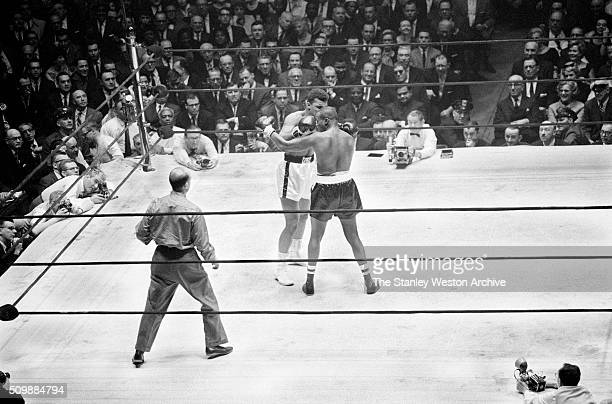 Cassius Clay in action throwing a left jab against Doug Jones during their heavyweight bout at Madison Square Garden New York New York March 13 1963
