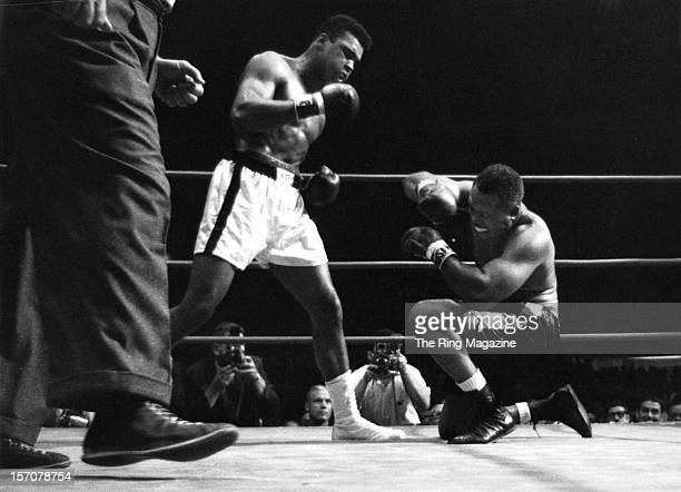 Cassius Clay knocks down Archie Moore during the fight at the Sports Arena on November 151962 in Los Angeles California Cassius Clay won by a TKO 4