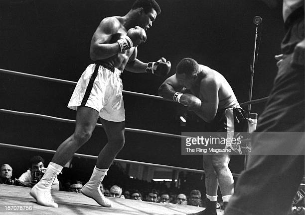 Cassius Clay lands a right hook to Archie Moore during the fight at the Sports Arena on November 151962 in Los Angeles California Cassius Clay won by...