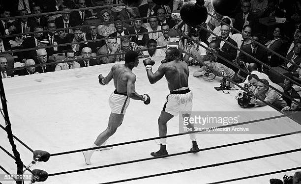Cassius Clay moves to land a punch against Sonny Liston at the Convention Center in Miami Beach Florida February 25 1964 Cassius Clay won the World...