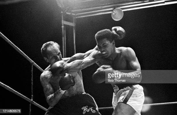Cassius Clay of the United States and Henry Cooper of Great Britain exchange blows during the WBC & WBA World Heavyweight Title fight at Highbury...