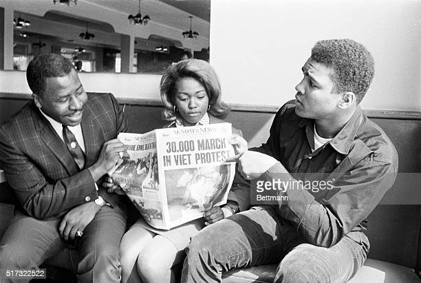 Cassius Clay points to newspaper headline to show he's not the only one protesting the Vietnam War March 28th The heavyweight champ was relaxing...