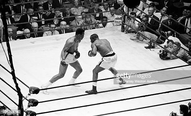 Cassius Clay prepares to throw a right against Sonny Liston at the Convention Center in Miami Beach Florida February 25 1964 Cassius Clay won the...