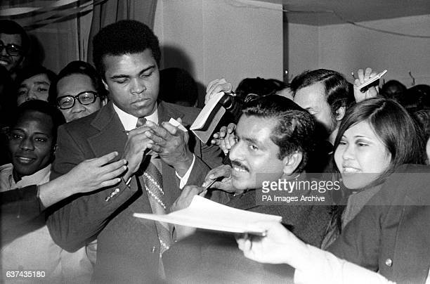 Cassius Clay signs autographs for adoring fans two days before his bout with Sonny Banks in New York