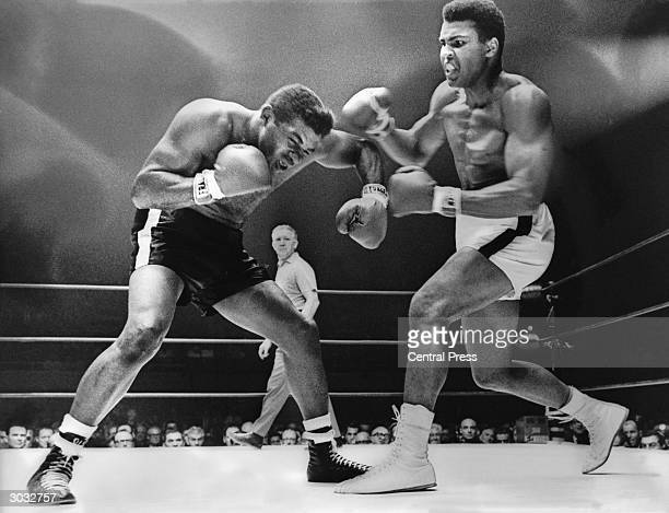 Cassius Clay spars with challenger Floyd Patterson during the World Heavyweight Championship fight Clay won the fight with a technical knockout in...
