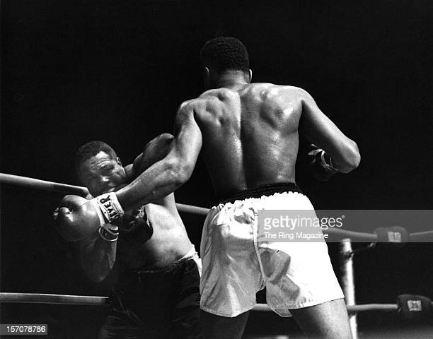 Cassius Clay throws a left hook to Archie Moore during the fight at the Forum on November 15 1962 in Los Angeles California Cassius Clay won by a TKO...