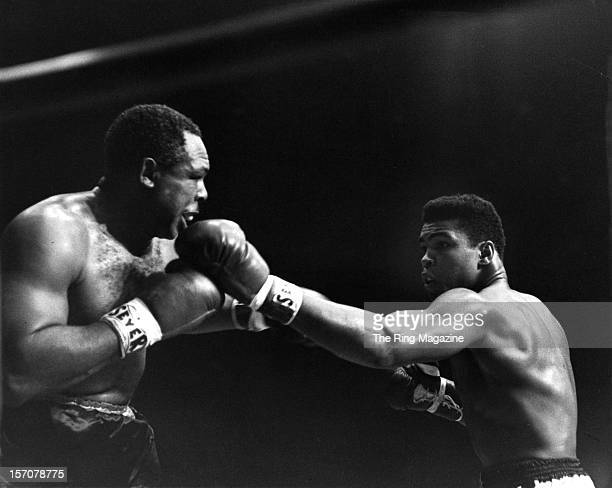 Cassius Clay throws a left punch to Archie Moore during the fight at the Sports Arena on November 151962 in Los Angeles California Cassius Clay won...