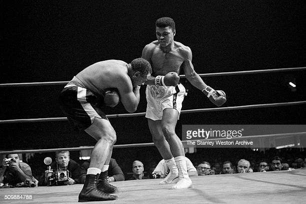 Cassius Clay throws a left punch to Archie Moore during the fight at the Sports Arena on November 15 1962 in Los Angeles California Cassius Clay won...