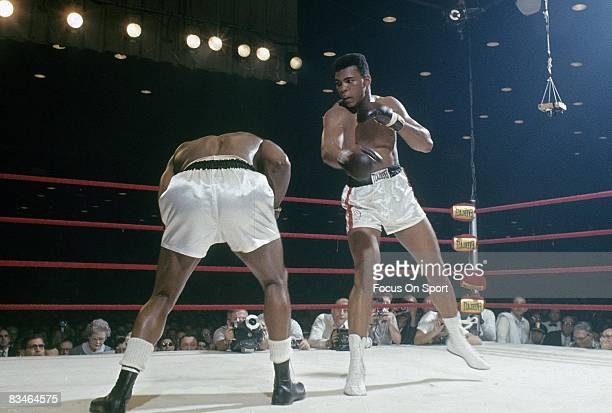 Cassius Clay throws a punch at Sonny Liston in a World Heavyweight Title fight February 25 1964 at Convention Hall in Miami Florida