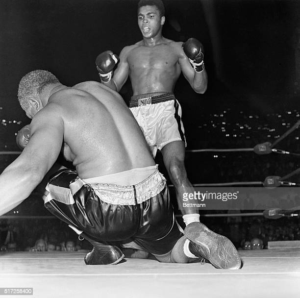Cassius Clay towers over the fallen Archie Moore after the last knockdown in the fourth round here November 15th Archie was called out at 135 of the...