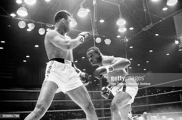 Cassius Clay uses the shoulder roll to defend against Sonny Liston at the Convention Center in Miami Beach Florida February 25 1964 Cassius Clay won...