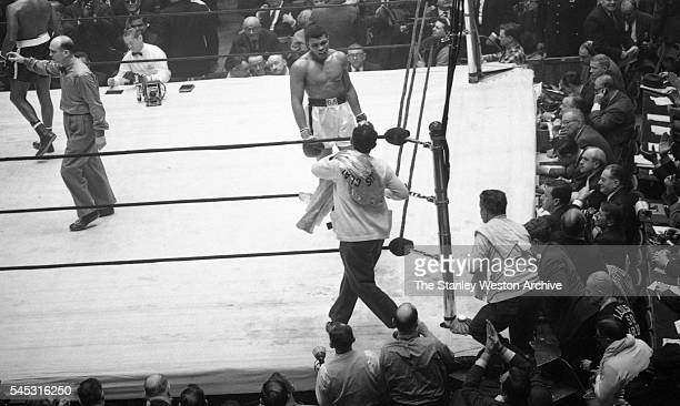 Cassius Clay walks to his corner after the final bell to wait for the decision vs Doug Jones during their heavyweight bout at Madison Square Garden...