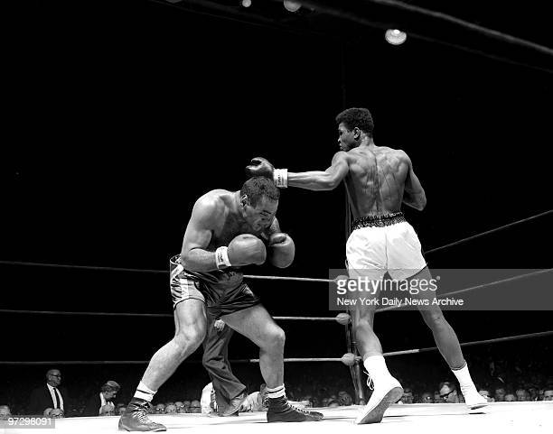 Cassius Clay wearing white trunks against Gary Jawish during Golden Gloves bout