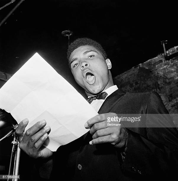 Cassius Marcellus Clay Kentucky's pugilistic poet reads one of his literary offerings during a contest at the Bitter End a Greenwich Village...