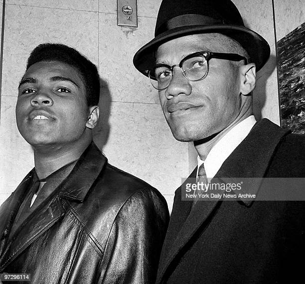Cassius Marcellus Clay with Black Muslim leader Malcolm X at 125th St and Seventh Ave