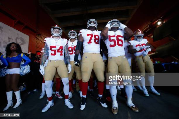Cassius Marsh Darrell Williams Jr #78 and Reuben Foster of the San Francisco 49ers wait to take the field prior to the game against the Los Angeles...