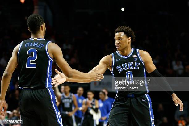 Cassius Stanley of the Duke Blue Devils celebrates with Wendell Moore Jr #0 against the Miami Hurricanes during the first half at the Watsco Center...