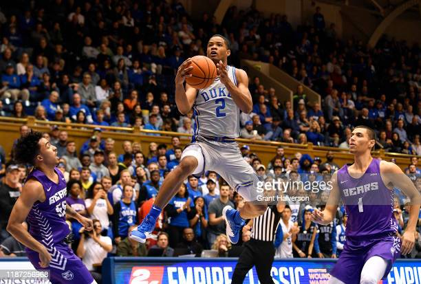 Cassius Stanley of the Duke Blue Devils drives between DeAndre Jones and Rylan Bergersen of the Central Arkansas Bears during the second half of...