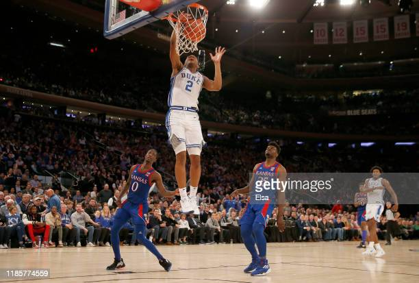 Cassius Stanley of the Duke Blue Devils dunks in the second half as Marcus Garrett and Udoka Azubuike of the Kansas Jayhawks defend during the State...