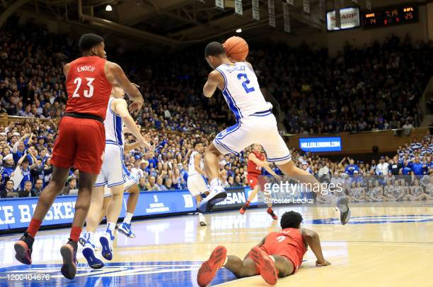 Cassius Stanley of the Duke Blue Devils goes after a loose ball over Darius Perry of the Louisville Cardinals during their game at Cameron Indoor...
