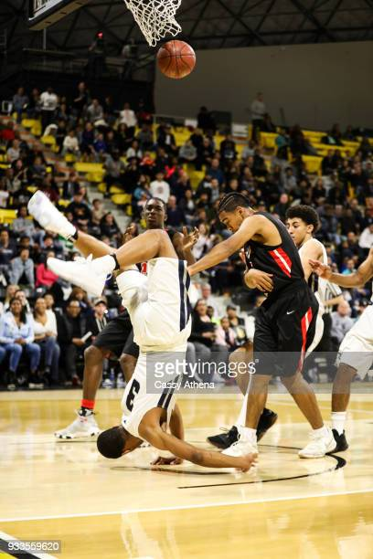 Cassius Stanley of the Sierra Canyon Trailblazers crashes to the floor over defender Krystian Wilson of the Etiwanda Eagles for the CIF State...