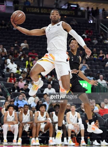 Cassius Stanley saves the ball from going out of bounds in front of Wendell Moore during the Jordan Brand Classic boys high school allstar basketball...