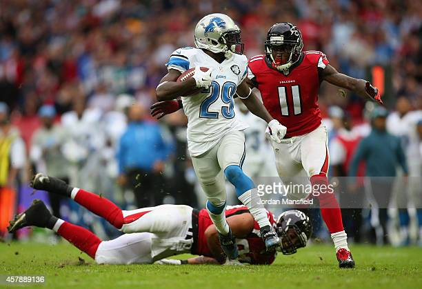 Cassius Vaughn of the Detroit Lions looks to break away from Julio Jones of the Atlanta Falcons during the NFL match between Detroit Lions and...
