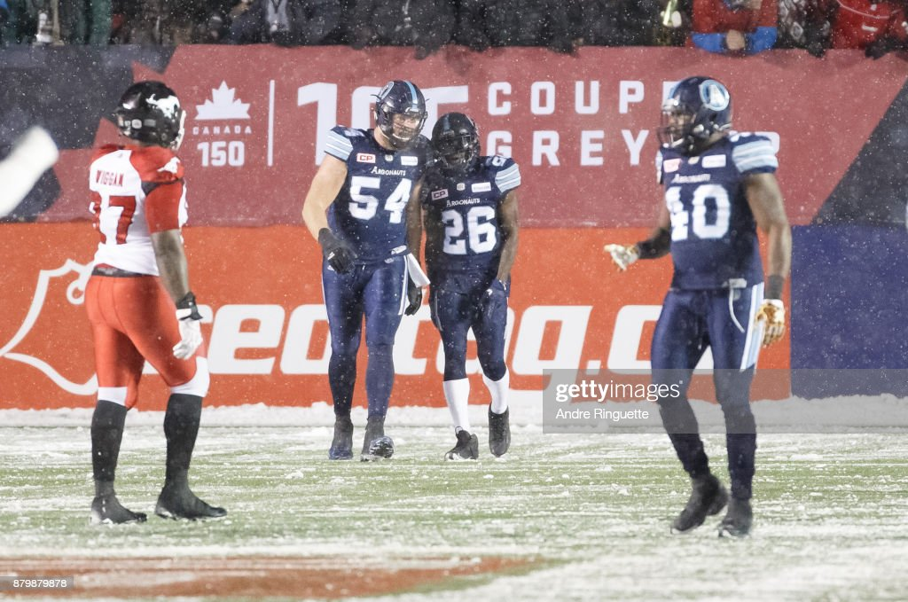 Cassius Vaughn #26 of the Toronto Argonauts celebrates his game-winning touchdown against the Calgary Stampeders with teammate Chris Van Zeyl #54 during the second half of the 105th Grey Cup Championship Game at TD Place Stadium on November 26, 2017 in Ottawa, Canada.