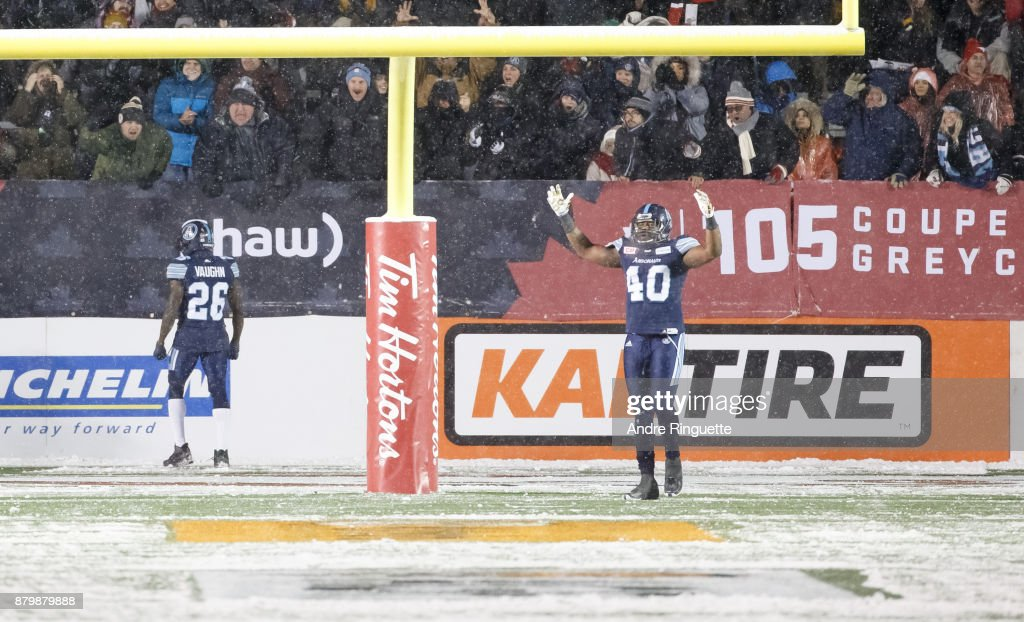 Cassius Vaughn #26 of the Toronto Argonauts celebrates his game-winning touchdown after running the ball the length of the field against the Calgary Stampeders with teammate Shawn Lemon #40 during the second half of the 105th Grey Cup Championship Game at TD Place Stadium on November 26, 2017 in Ottawa, Canada.