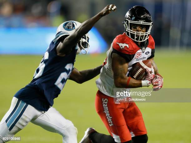 Cassius Vaughn of the Toronto Argonauts goes to tackle Marquay McDaniel of the Calgary Stampeders during a CFL game at BMO Field on August 3, 2017 in...