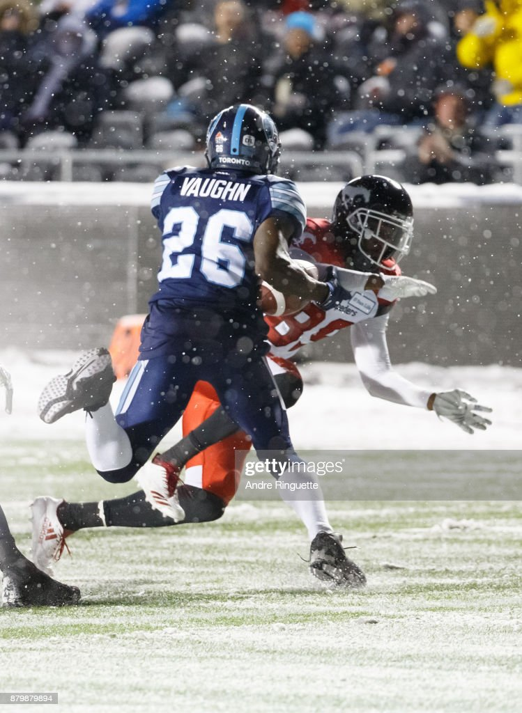 Cassius Vaughn #26 of the Toronto Argonauts picks up the ball after fumble against DaVaris Daniels #89 of the Calgary Stampeders during the second half of the 105th Grey Cup Championship Game at TD Place Stadium on November 26, 2017 in Ottawa, Canada.