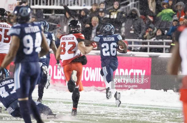 Cassius Vaughn of the Toronto Argonauts runs the ball the length of the field for the game winning touchdown after picking up a fumble against the...