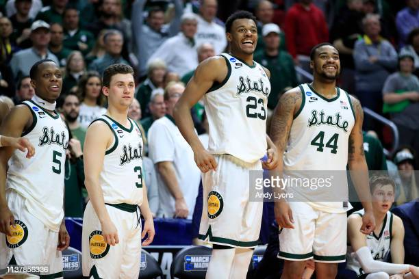 Cassius Winston Foster Loyer Xavier Tillman and Nick Ward of the Michigan State Spartans celebrate from the bench against the Minnesota Golden...