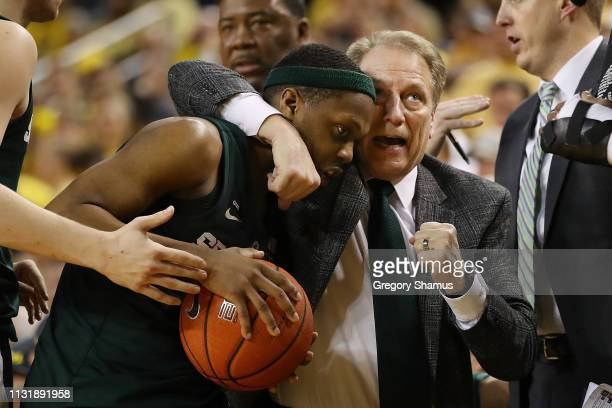 Cassius Winston of the Michigan State Spartans and head coach Tom Izzo react while playing the Michigan Wolverines at Crisler Arena on February 24...