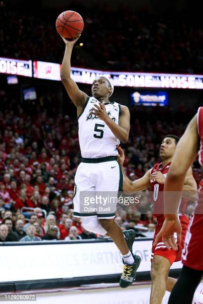 Cassius Winston of the Michigan State Spartans attempts a shot in the second half against the Wisconsin Badgers at the Kohl Center on February 12...